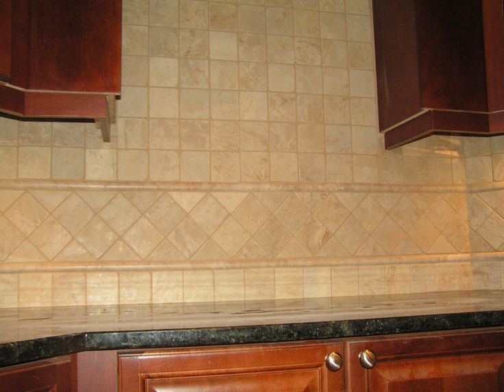 Travertine floors and backsplash in kitchen | We