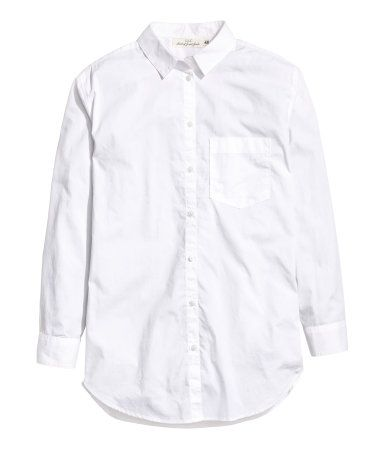 White. Wide-cut shirt in woven cotton fabric with a turn-down collar, chest pocket, and cuffs with buttons. Rounded hem, slightly longer at back.