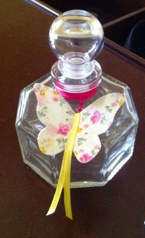 Bottle of olive oil decorated with fuschia waxthread, floral fabricbutterflies and yellow ribbon - Μπουκάλι λαδιού στολισμένο με φούξια κηροκλωστή, υφασμάτινε πεταλούδες και κίτρινη κορδέλα #bottle #christeningbottle #handmadedecor #almanogr #μπουκαλιλαδιου