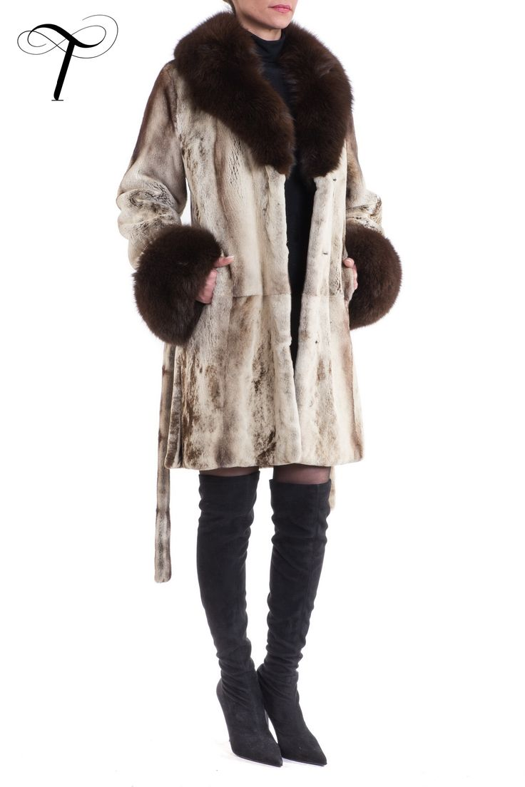 SHEARED MINK COAT  This #sophisticated #coat will be a #timeless addition to your wardrobe. Crafted from brown cross sheared #mink #fur, it is designed in a straight line with side vents. The coat features a #foxfur notch collar and matching fox #fur cuffs. A sheared #mink #fur self-tie belt gives the option of a more fitted figure. You can wear it over any #outfit as it offers an urban #style that does not fear #elegance. #furcoat #fourrure #mexa #pelliccia #fashion #toutountzisfurs #chic