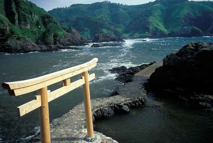 Wooden gate overlooking the ocean on the Oki Islands, Japan. Image by Jim Holmes / Axiom Photographic Agency / Getty Images.