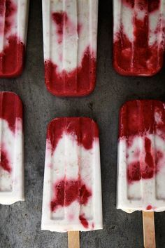 Recipe for Roasted Strawberry and Toasted Coconut Popsicles - They're tie dye speckled and dang delicious. These popsicles aren't overly sweet but the strawberry and coconut flavors are all up in your business!