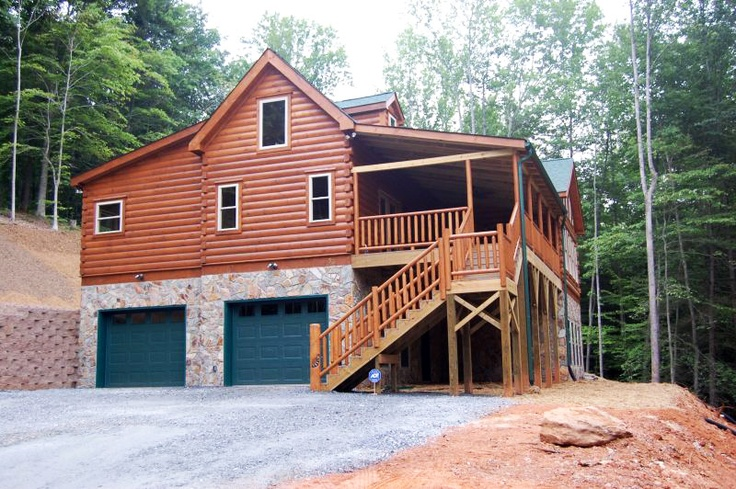 Blowing rock log cabin floor plan designed by blue ridge for Log cabin house plans with garage