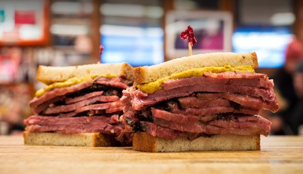 """Shown:  #3. A PASTRAMI SANDWICH AT KATZ'S DELICATESSEN where """"When Harry Met Sally"""" was famously filmed! 