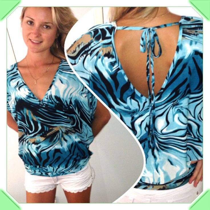 Bright blue and white top with butterfly sleeves and open, tie-up back