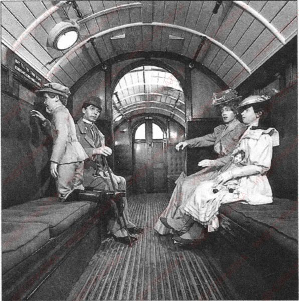 In the carriage of the London Underground. The end of the XIX century.