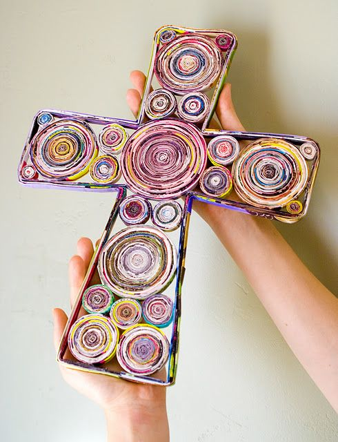 cross made from rolled magazine pages