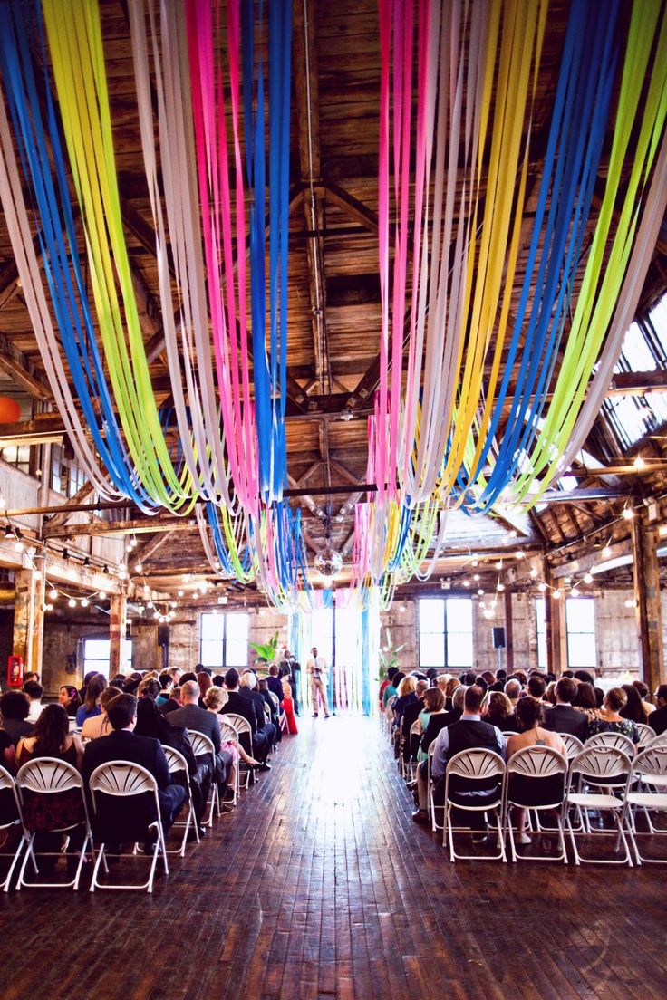 Ribbon wedding decoration is pretty, but super expensive. Use flagging tape for the same look, without spending a million dollars.