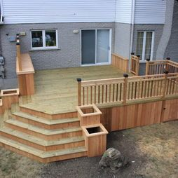 LOVE the steps with the flower boxes off the deck!
