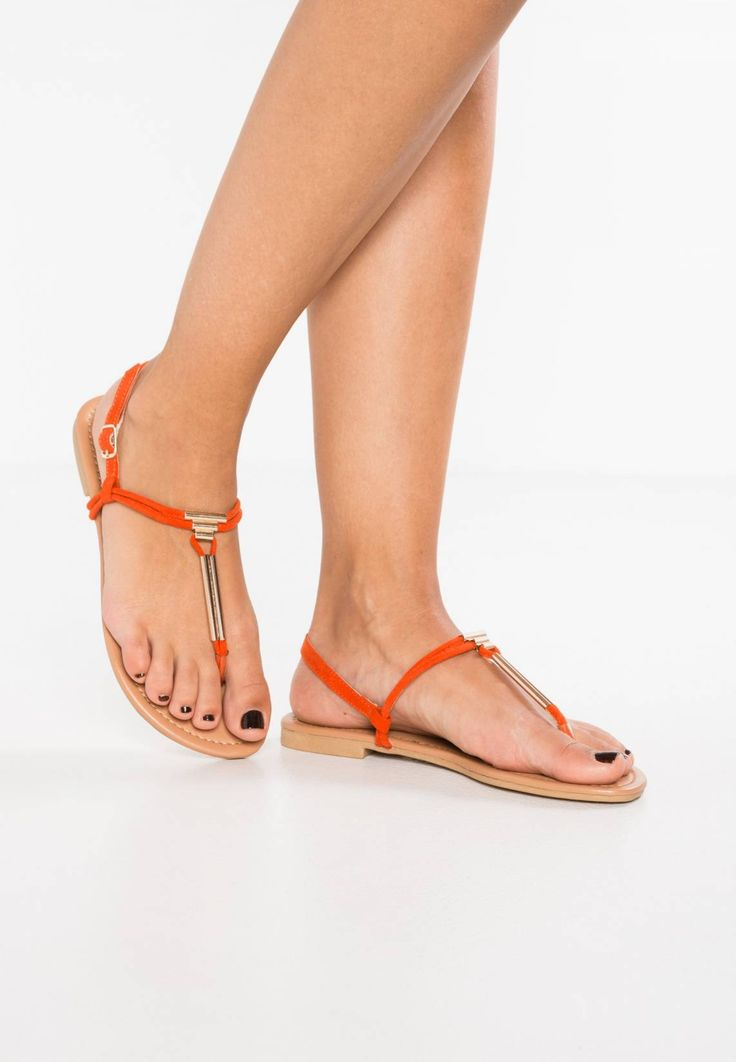 New Look Wide Fit. IMMENSE 2 - T-bar sandals - orange. Sole:synthetics. Padding type:Cold padding. Shoe tip:open. Heel type:flat. Lining:imitation leather/ textile. detail:elasticated. shoe fastener:buckle/bow. upper material:textile. shoe width:large....