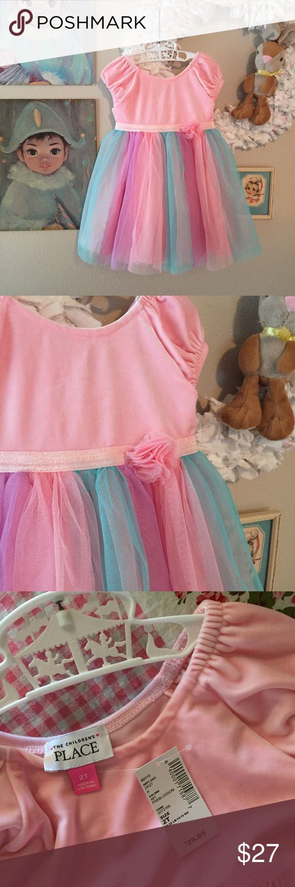 NWT TUTU spring dress Sadly won't fit my daughter this year for Easter 😔. Darling soft velvet top with cap sleeves, glitter waistband, Pom Pom tulle flower, and cotton candy full tulle tutu style skirt - lined slip. A pastel dream! Would even make a great birthday party dress for a unicorn or princess theme. Very sweet. The Children's Place Dresses