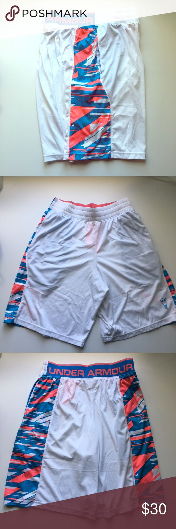 Under Armour // Multi Colored Lacrosse Shorts Fun and festive shorts from Under Armour's lacrosse line. White legs with blue and pink camouflage design on the sides. Two hip pockets. Second photo is the front and third photo is the back. 100% polyester. Have been worn, in great condition. Under Armour Shorts Athletic