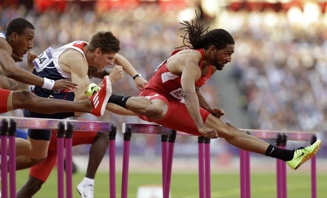 United States' Jason Richardson leads Cuba's Orlando Ortega and Britain's Lawrence Clarke during their men's 110-meter hurdles semifinal.