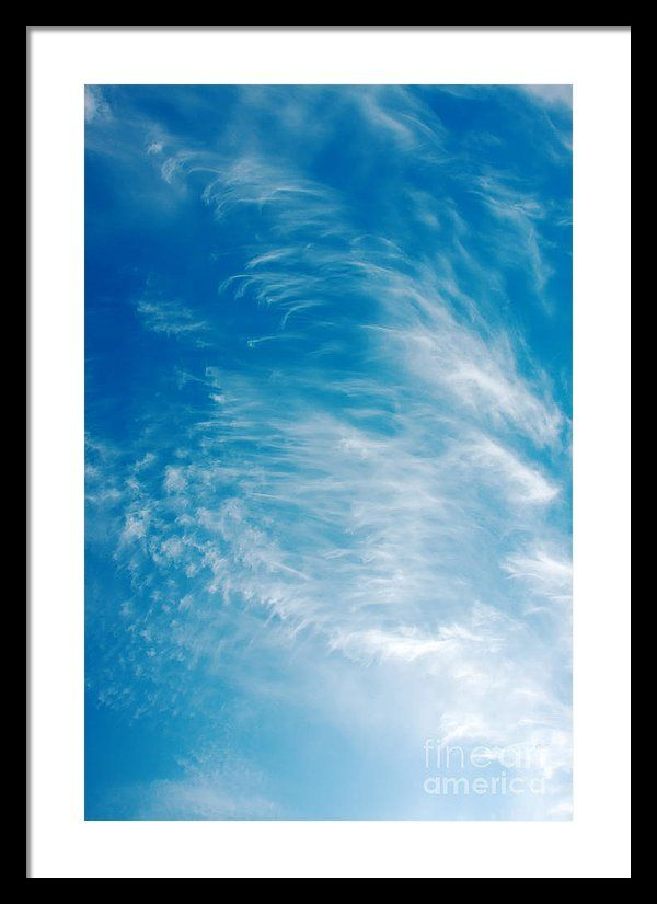 Backgrounds Framed Print featuring the photograph Strong Winds Forming Cirrus Clouds With A Deep Blue Sky. by Jan Brons. Strong winds forming cirrus clouds with a deep blue sky.     Cirrus clouds are mostly a sign of changing weather, often more stormier weather. As a sailor I notice that a day later the winds are much stronger.   Take a look at the cirrus wikipedia page for more information on the interesting subject of meteorology.