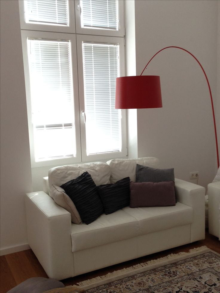 Statement red arching floor lamp