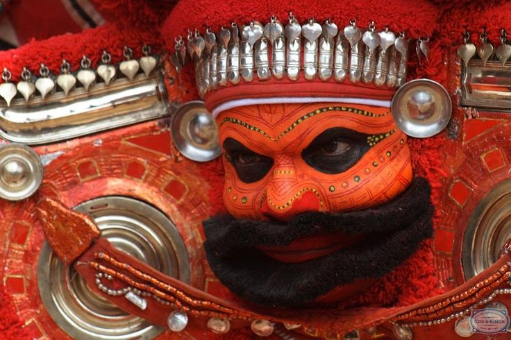 A Theyyam dancer in full make-up and traditional gear