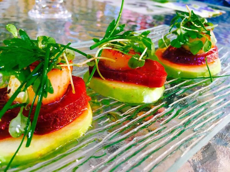 Scallops on green apple and red beets. Olive oil, white balsamic vinegar and a salad of chive, parlsey and arugula