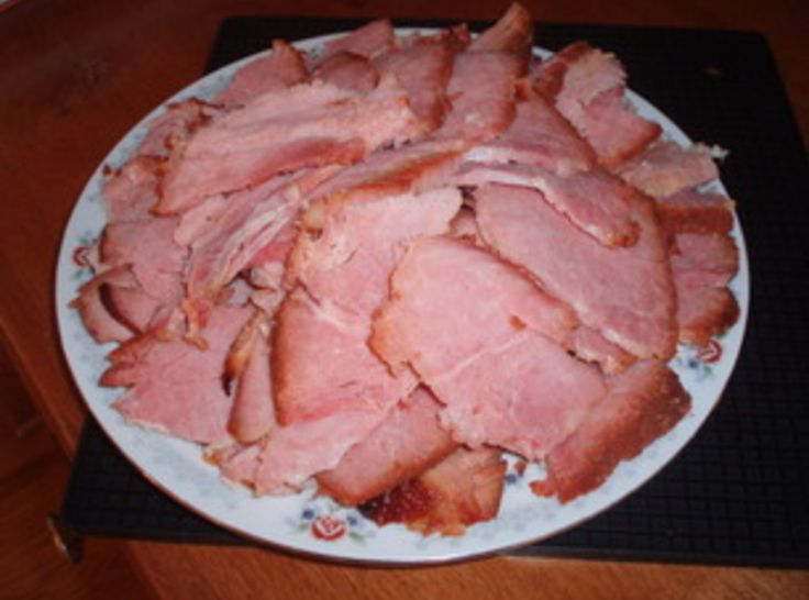 Honey Baked Ham done simple: Need10 to 12 lb uncooked shank portion ham, 3 Tbsp. Dijon mustard, 1 cup brown sugar,1/2 cup honey, 1tsp. cinnamon. Trim fat & score in a diamond pattern. It not only looks nice but allows the fat to render while cooking. Bake at 325 for 20 mins per lb until internal temp is 160. Mix mustard, brown sugar, honey, & cinnamon together. During last 45 mins of baking spread this glaze over ham. When done slice thin & enjoy.