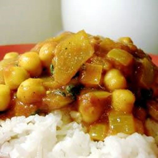 This chickpea and tomato based Indian curry has a blend of fragrant spices is warming and healthy. Serve with a dollop of natural yoghurt, a sprig of coriander and warm naan.