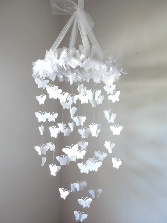 hanging in Scarlett's room at  Grammie and Papa's house  white Chandelier Butterfly Mobile by LittleBoPress on Etsy,