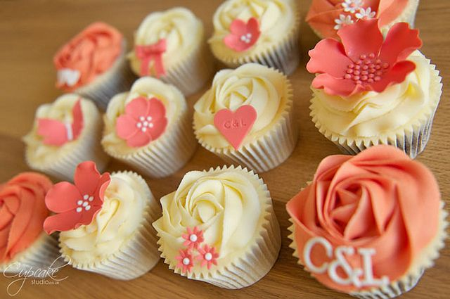 coral and off-white cupcakes with flowers, hearts and initials @Joelle Seesing