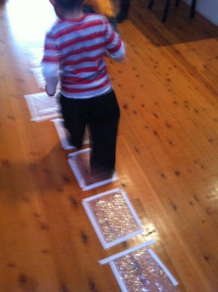 Bubble wrap hopscotch.  Sounds like fun.  :)