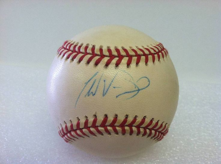 Todd Van Poppel Autographed Baseball. This baseball has yellow spotting and is sold as is.