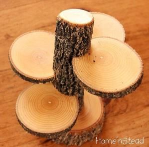 Rustic cupcake or display stand from branch and log slices. by winnie