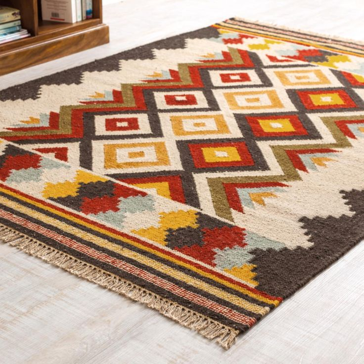 Navajo Kilim Rug hand woven by skilled Indian artisans on traditional flat looms and finished with fringe trims, these fair trade will transform any home.