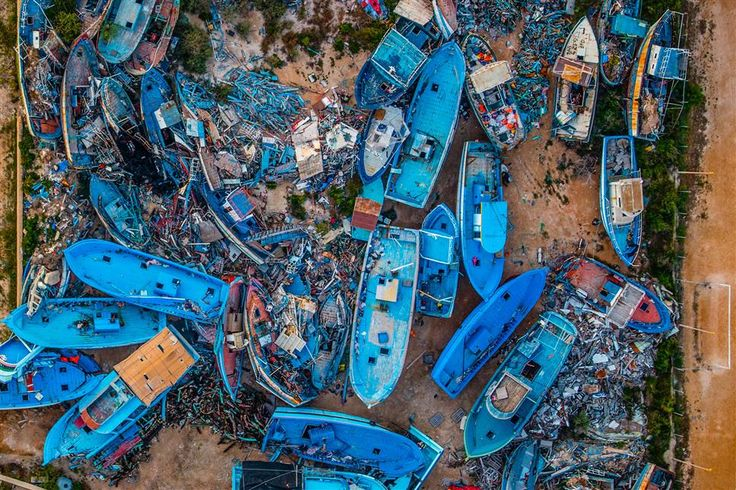 Lampedusa (Italy) Mare Nostrum operation, aerial view zenith of the cemetery of boats shipwrecked migrants arriving in the sea of Lampedusa 2014-05-29 © Massimo Sestini