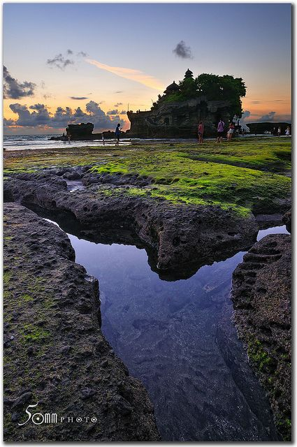 """Tanah Lot, one of the most popular places of interest in Bali, is located on the coast of West Bali, at the village of Beraban in the Tabanan Regency, about 20 km from Denpasar.    Tanah Lot means """"Land (in the) Sea"""" in Balinese language. It sits on a  Discounted Hotels! Check out this awesome Hotel Comparison Site I found = >  http://searchcheaphotelsnow.com"""