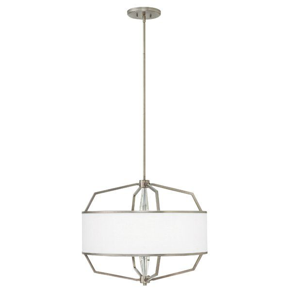 Combining the clean lines of an angular, architectural frame with a white linen hardback drum shade, Larchmere elevates the minimalist geometric form to a new level of transitional elegance. Subtly integrating chic design elements, from a heavy crystal center column, metal trim shade detailing an etched glass diffuser, underscore an attention to detail that yields Larchmere's discerning silhouette.