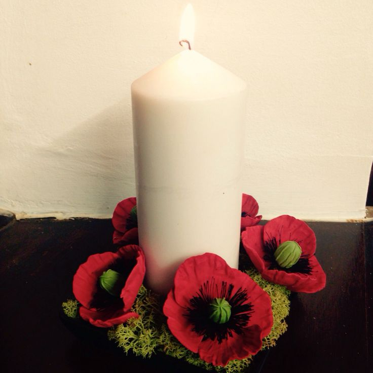 Poppies around a candle
