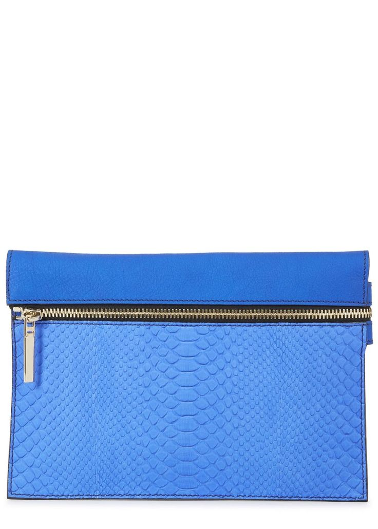 Make a statement with this bright blue Victoria Beckham pyhton clutch. Buy in store and online now at Harvey Nichols.