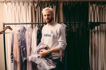 Alexander Lewis arranging rails of clothing before the show | Alexander Lewis AW16 Presentation - Behind the Scenes at London Fashion Week