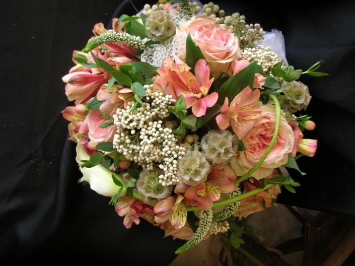 Vintage bridal bouquet with peach garden roses, alstroemeria lilies and berries, rice flowers
