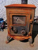 Use an old cast iron wood stove to make a slumping kiln.