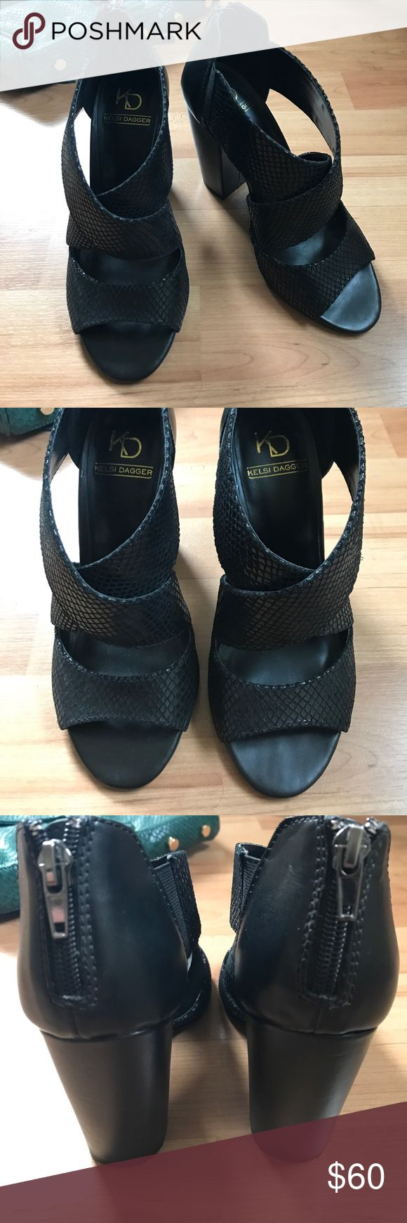 Kelsi Dagger Black Faux Snakeskin Open Toe Sandals Pre-loved Kelsi Dagger black faux snakeskin open toe chunky heel sandals in size 6.5. Back zippers are hard to open. Comes from a pet and smoke-free home. Kelsi Dagger Shoes Heels