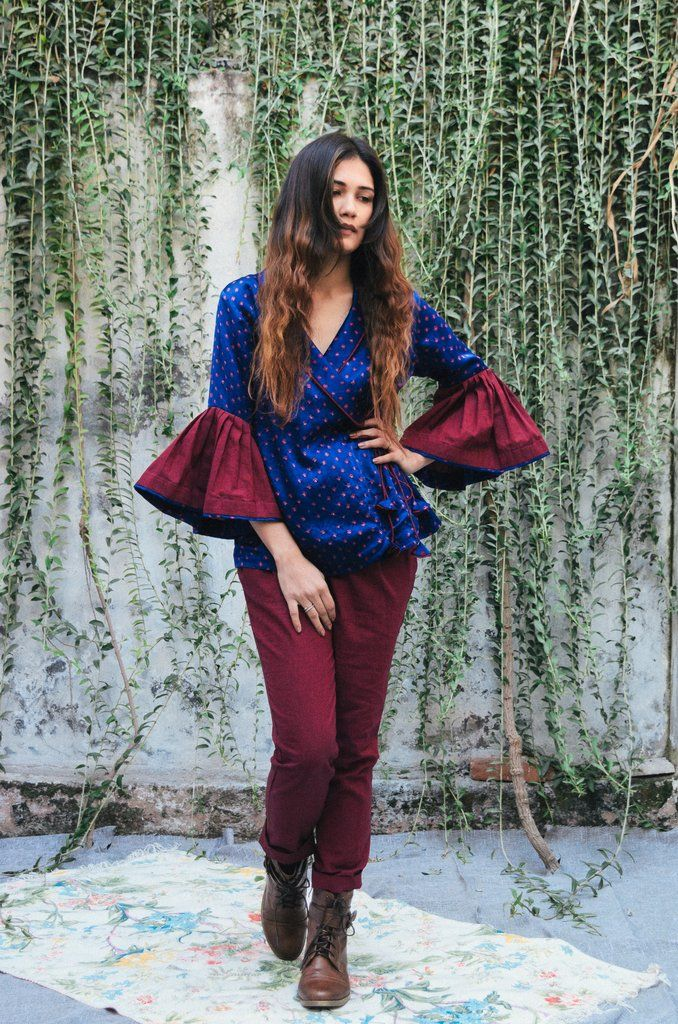 """Add a little drama to your wardrobes with thiswrapjackettop, crafted from hand tied/dyed silk bandhej, with shawl collar and dramatic flared sleeve cuff. STYLE TIP:wrap it up with boot cut denims or trousersDETAILS -Hand tied/dyed silk bandhani + cotton inner line-Hand dyed-Straight fit-Slightly loose at the waist-Shawl collar-Tie ups for closer-Straight sleeves with flared cuff-Dry clean onlyREADY GARMENT MEASUREMENTS  XS:Chest-34"""", waist: 28, garment length-26"""",slee..."""