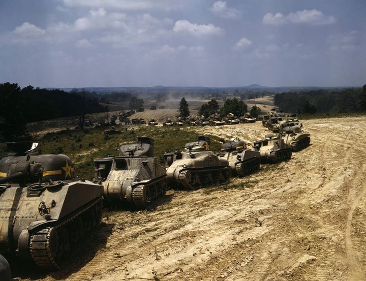 A column of M4 Sherman M3 Lee and M3 Stuart tanks in training maneuvers Fort Knox Kentucky United States June 1942.