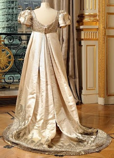 White satin dress c. 1790's, with silver tulle trim, cabochons, silver, and glass beads.