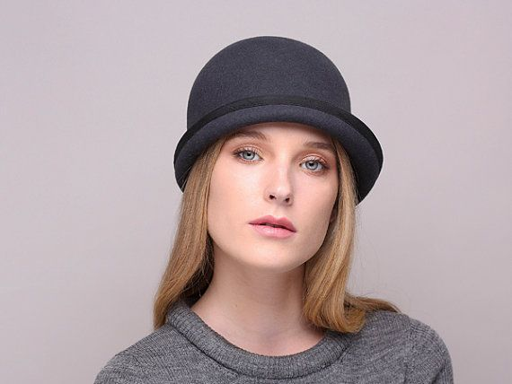 This classic minimalistic beanie hat has a round head and short upper brim. The hat has an inner millinery flexible wire in the brim that keeps its shape. Materials: 100% wool felt, cotton The hat will arrive packed on a special plastic insert ensuring safe transportation. You will