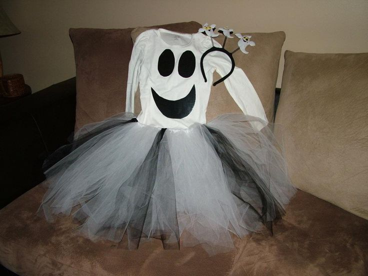 DIY simple ghost costume for girl. Use black duct tape for eyes mouth on white shirt and make a simple tutu, pair with black leggings.