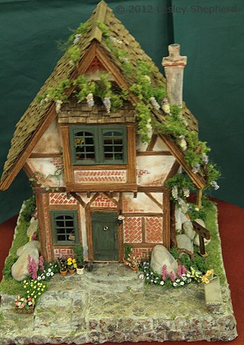 Front view of Tudor Times, a quarter scale dollhouse exhibited by Joane Forsstrom.