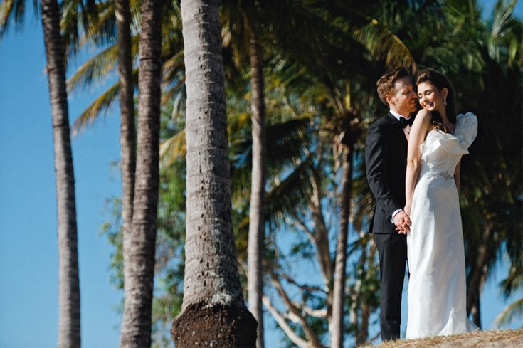 Port Douglas Wedding Photography. Byron and Elise, cuddling in the coconuts at Rex Smeal Park in Port Douglas. Destination Wedding Photography. www.shaunguestphotography.com.au