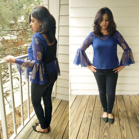 Check out this item in my Etsy shop https://www.etsy.com/listing/513911467/navy-blue-chiffon-low-cut-back-sheer-top