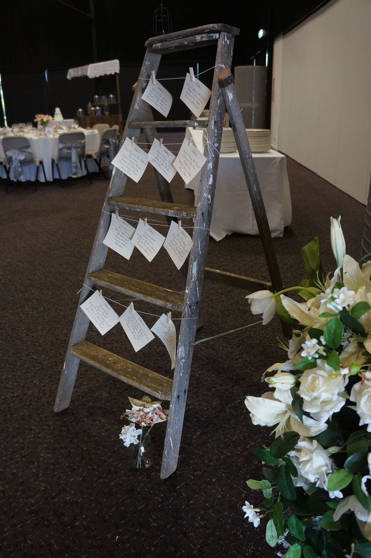 Love how grandma's ladder is used for a seating chart.  www.tailracecentre.com.au