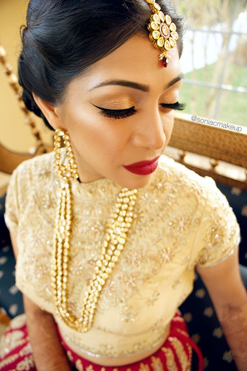 indian bridal makeup, bridal makeup, red lips, wing liner, sabyasachi bride, soniacmakeup, sonia c
