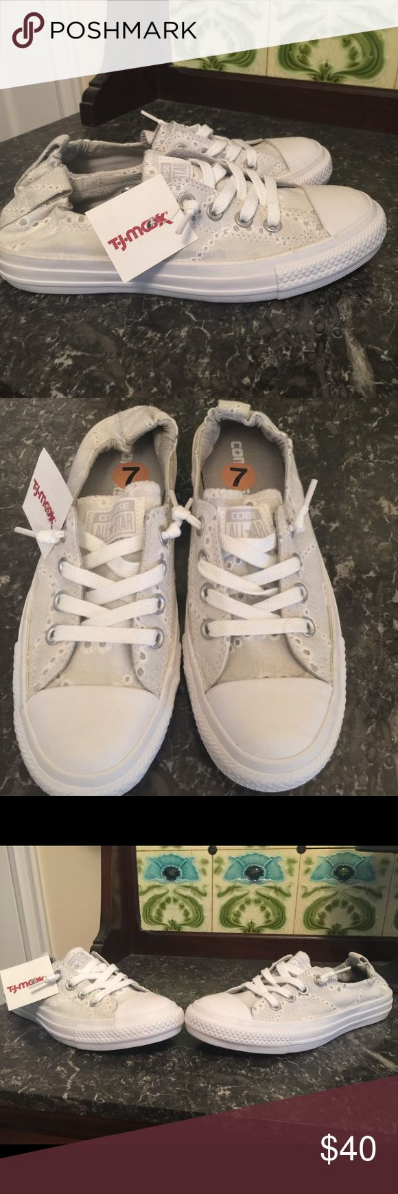 NWT Ladies Converse White Eyelet Sneakers Solid white, including the Converse tag on the back, eyelet sneakers.  Stretchy back for easy slip on and off.  Laces up the front.  Absolutely darling.  NWT. Converse Shoes Athletic Shoes