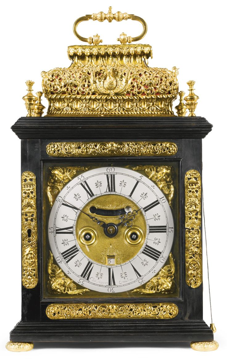 A gilt-mounted ebony quarter repeating table clock, Charles Burges, London, circa 1705 7-inch dial with winged cherub spandrels, signed Cha Burges, London, matted centre with mock pendulum and engraved date apertures and ringed winding holes, strike/silent lever at XII, the two train fusee movement with seven knopped pillars, verge escapement, internal rack striking on a bell, pull quarter repeating on a nest of five bells,